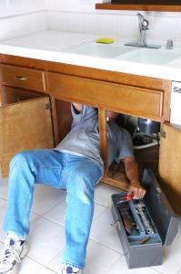 one of our Wylie plumbers is fixing a garbage disposal
