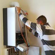 a professional tech from our Wylie plumbers company is repairing a water heater